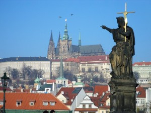 Statue of St. John the Baptist pointing at Prague Castle